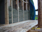 Hemp & lime wall in progress on tricky gable end of straw bale porch
