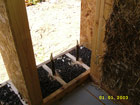 Drainage layer below the straw bale wall