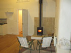 Log stove to heat straw bale bungalow
